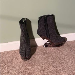 Black stud boots with spike heels